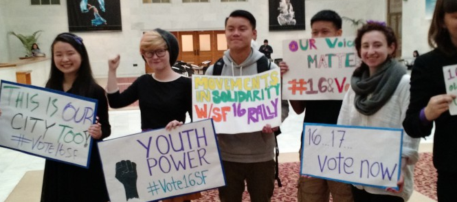 Young activists in San Francisco holding signs advocating for a lower voting age