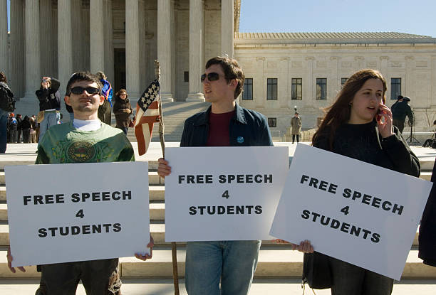"Three students holding signs reading ""Free Speech 4 Students"" outside the US Supreme Court."