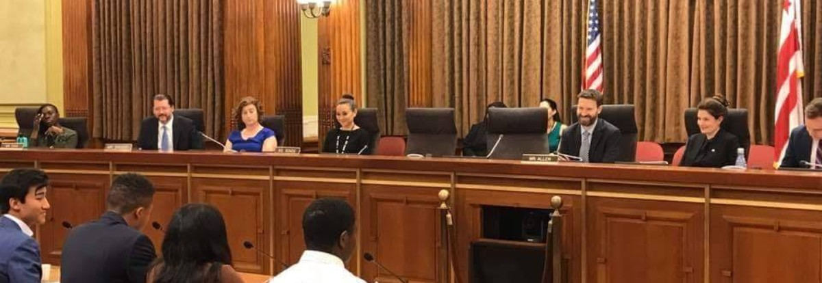 Washington D.C. City council members sit listening to people testify in favor of lowering the voting age