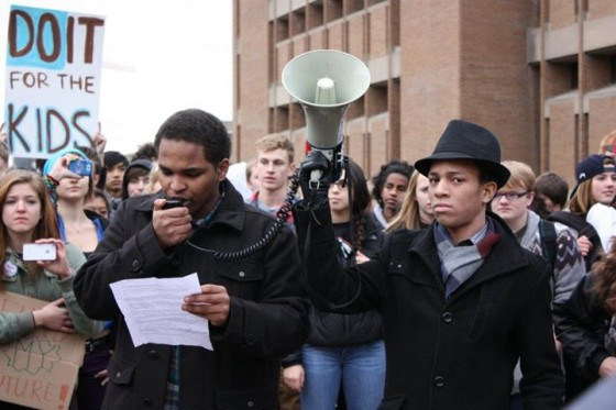 Students gathered in a protest - one with a bullhorn