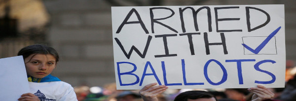 "Protest sign saying ""Armed with Ballots"""